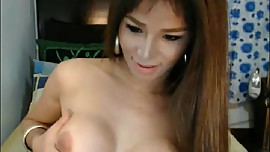 Beautiful Busty Babe faps hard tranny cock