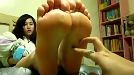 mum tickles daughters feet