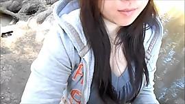 Sweet Asian girl sucking cock in public park
