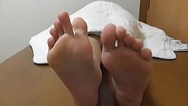 Japanese girl shows her smooth soles