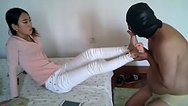 asian girl use foot slave