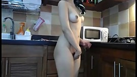 Cute Asian chick attempts to handle Ohmibod in kitchen